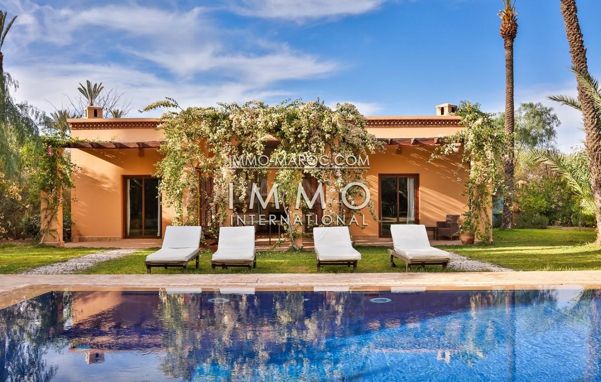 Très belle villa de style Marocain et art déco située dans un secteur de la palmeraie calme et accessible .  Parc sublime, villa principale avec piscine et maison d'ami avec piscine . picture 19